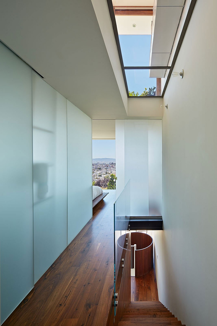 Sky lights usher in natural ventilation into the bedroom with San Francisco Skyline views