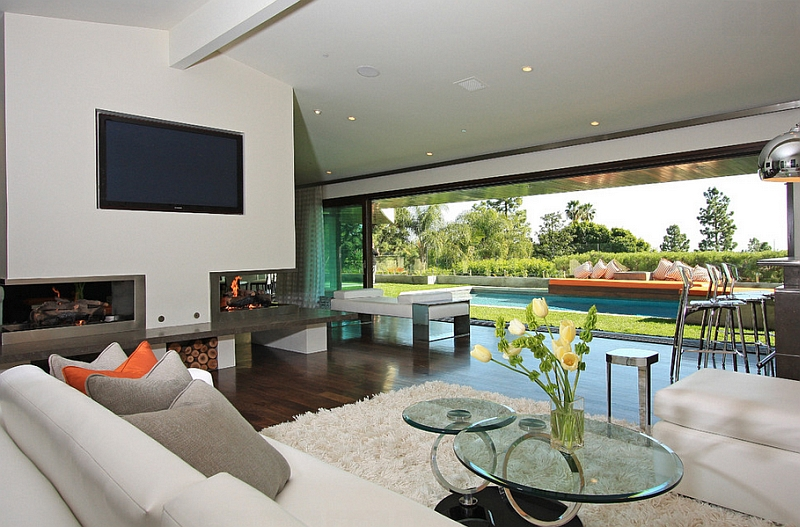 Sliding glass doors connect the interior with the world outside