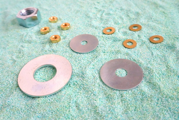 Washers and hex nuts in silver and gold tones