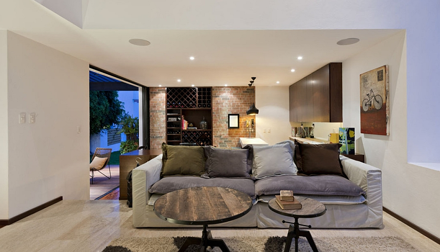 Beautiful brick wall adds visual contrast in the living space