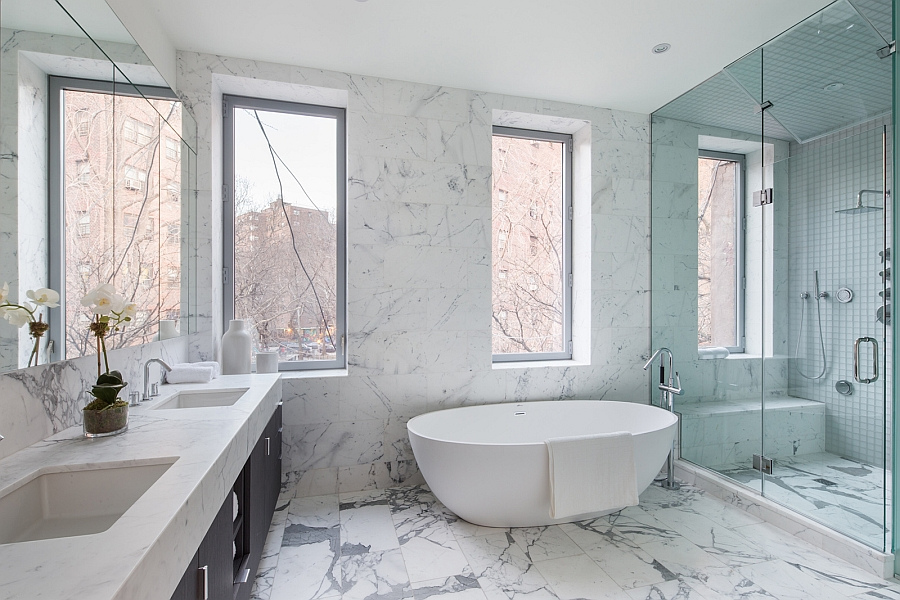 Exquisite contemporary bathroom in marble with a freestanding tub