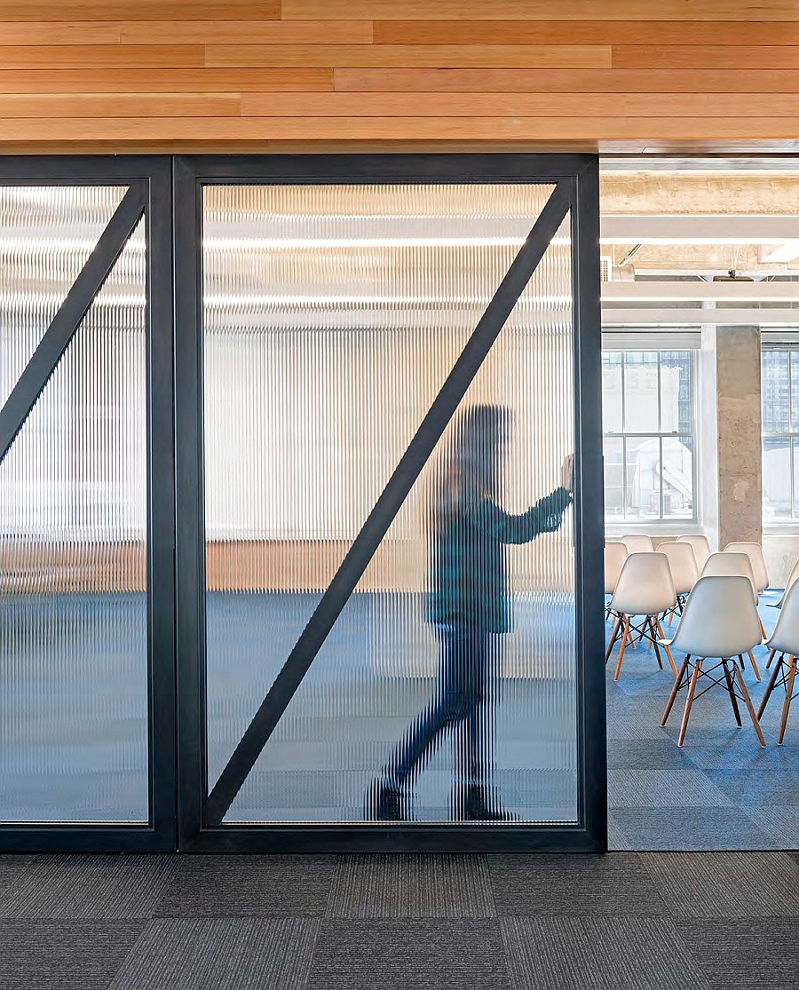 Frosted sliding glass doors give ample privacy even while letting in ventilaton