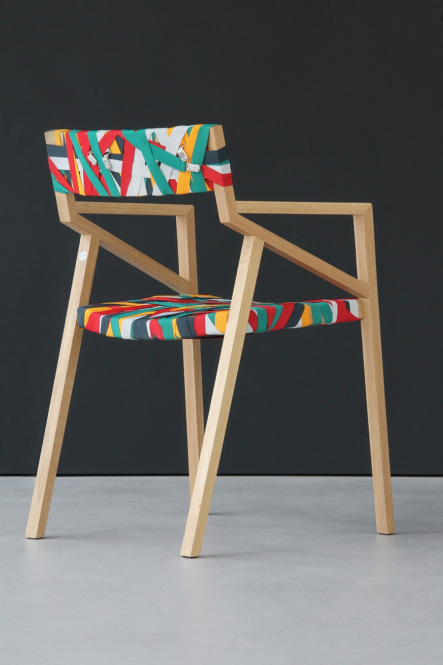 Gorgeous chair with a solid wood frame and wrapped in colorful suspenders