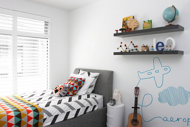 Sleek floating shelves and bed for the kids' room