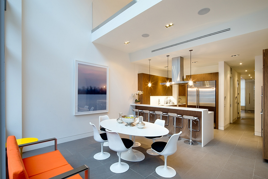 Tulip dining table and chairs save up on precious foot space