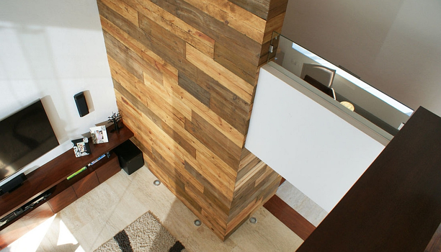 Wooden accent wall in the living room adds textural contrast
