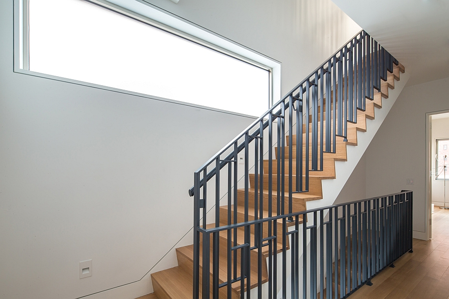 Wooden staircase with steel railing