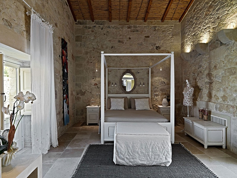 Beautiful four-poster bed brings modern comfort to the historical room