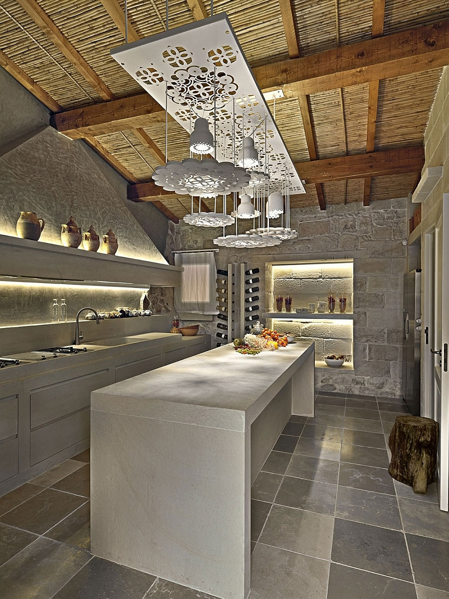 Elegant kitchen with an intoxicating wine collection and sculptural lighting