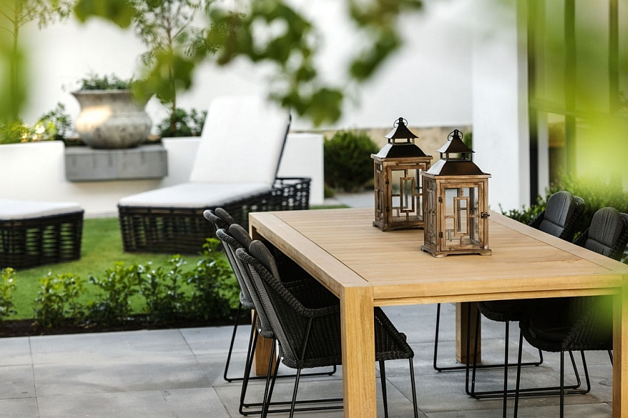 Lantern-styled lighting and decor in natural materials shape the outdoor