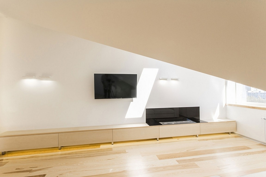 Low-slung entertainment unit and wall-mounted TV save up on space