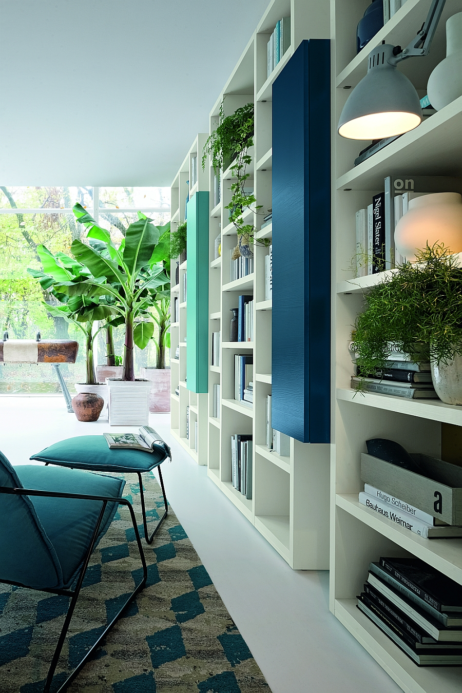 Natural greenery adds to the vibrant style of the wall unit system