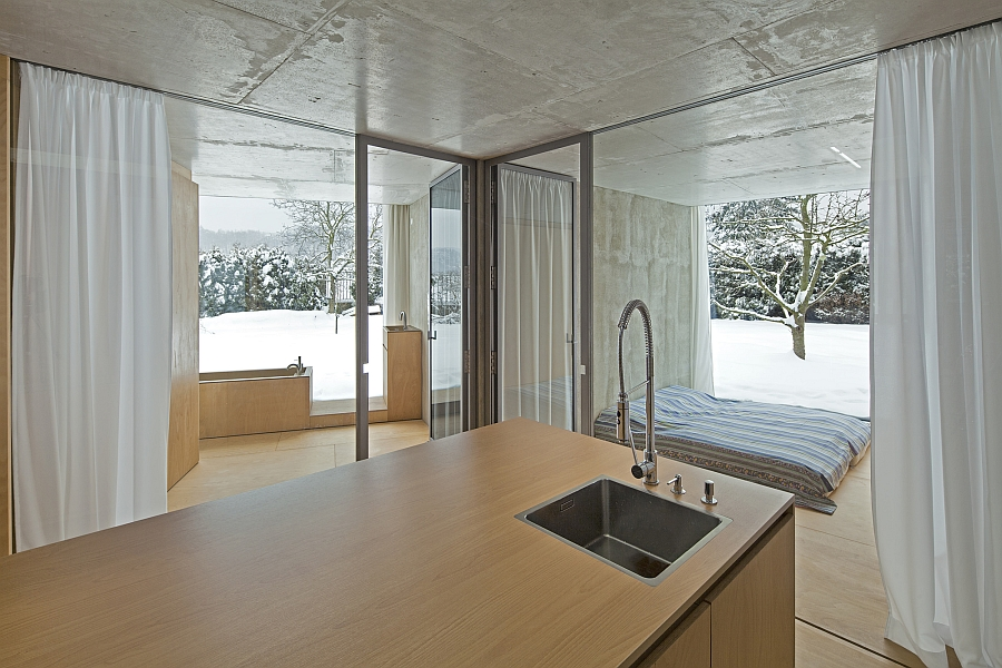 Simple and minimal kitchen island covered in wood