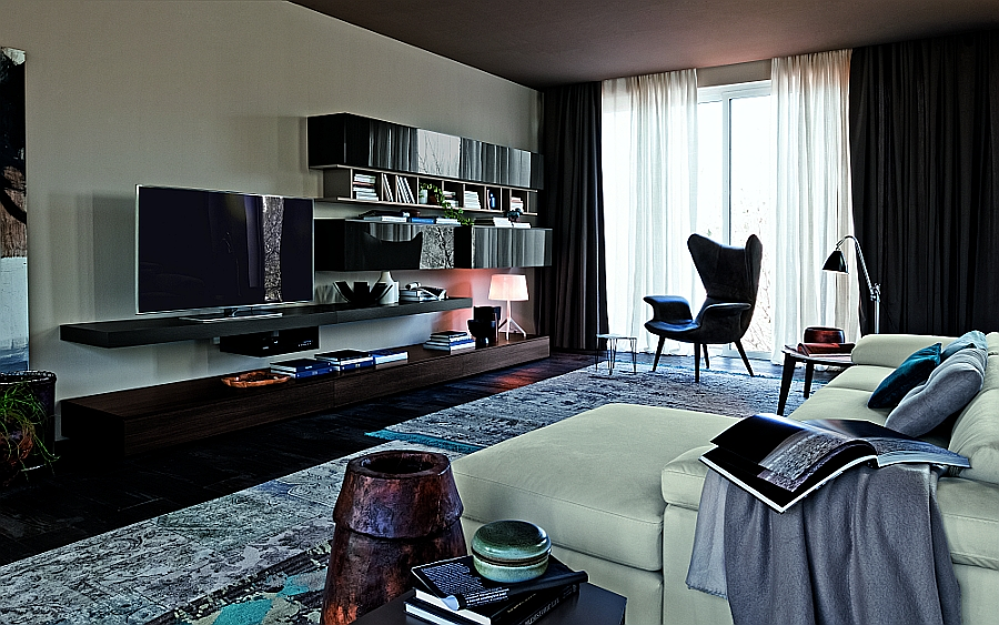 Sleek, floating wall unit shelves help give the room a visually lighter appeal