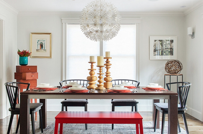 Smart dining room with lovely pops of color and a bold pendant light