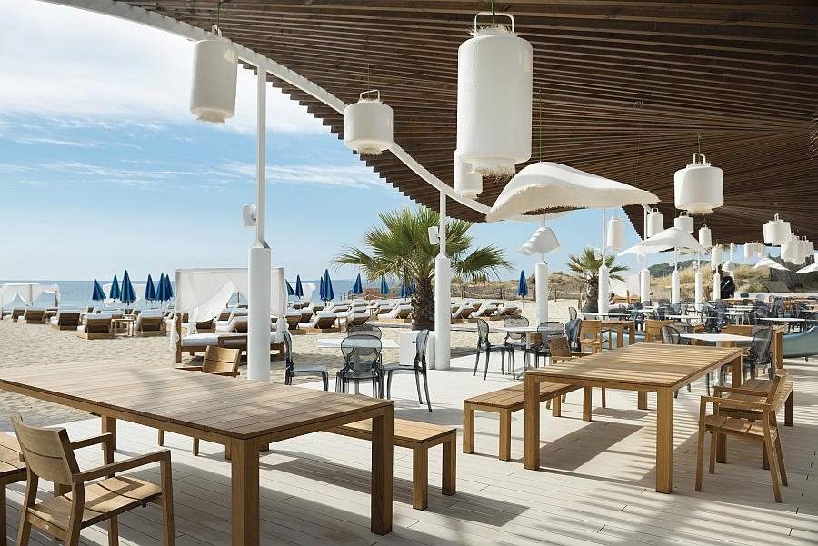 Stylish lighting fixtures and outdoor decor shape the Beach Club in Ibiza
