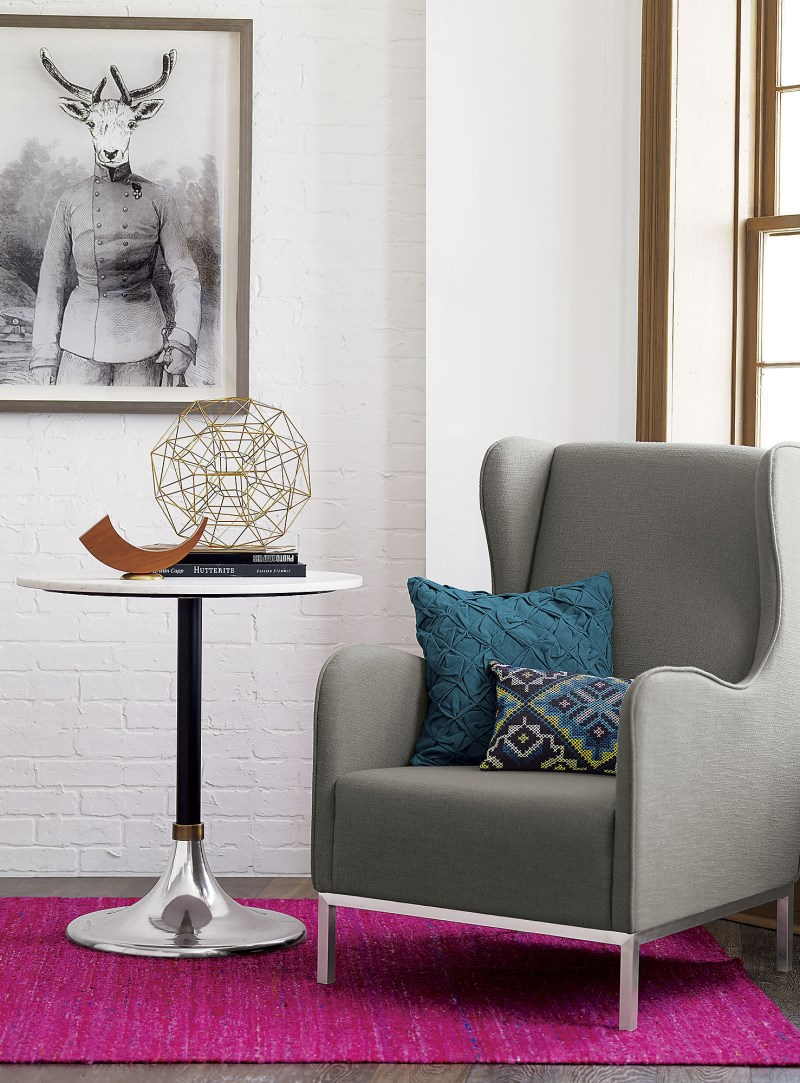Berry rug and blue pillows from CB2
