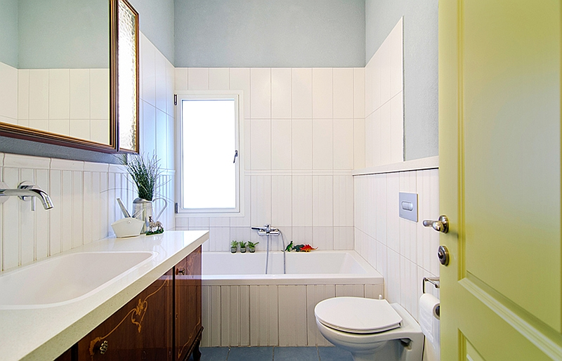 Blue floor and white tiles in the bathroom with a touch of classic design