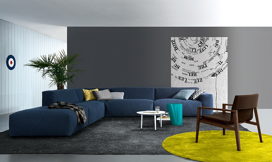 Coffee table in white stands out visually thanks to the bold couch in blue