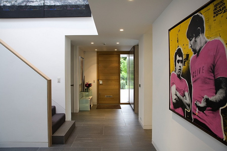 Entrance of the modern London home with interesting wall mural additions