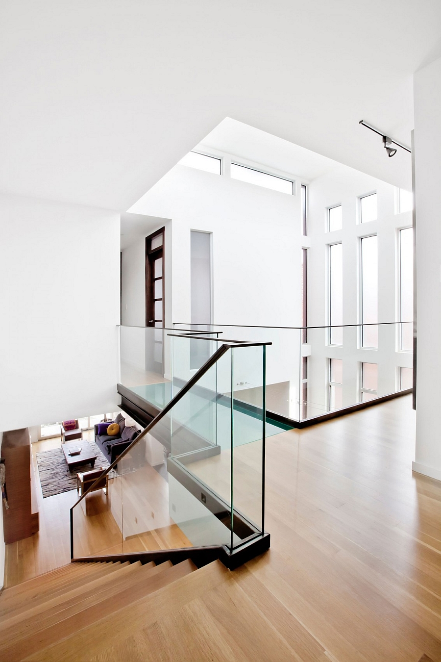 Glass staircase railing and walkway give the home an airy appearance