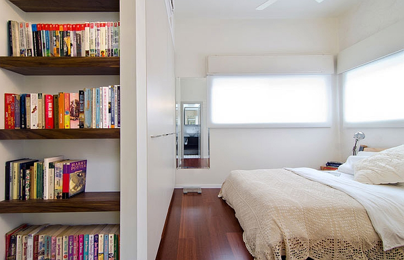 Lovely corner shelf in the trendy apartment bedroom saves up on space