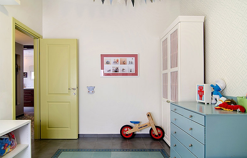 Painted doors and colorful cabinets bring life to the nursery