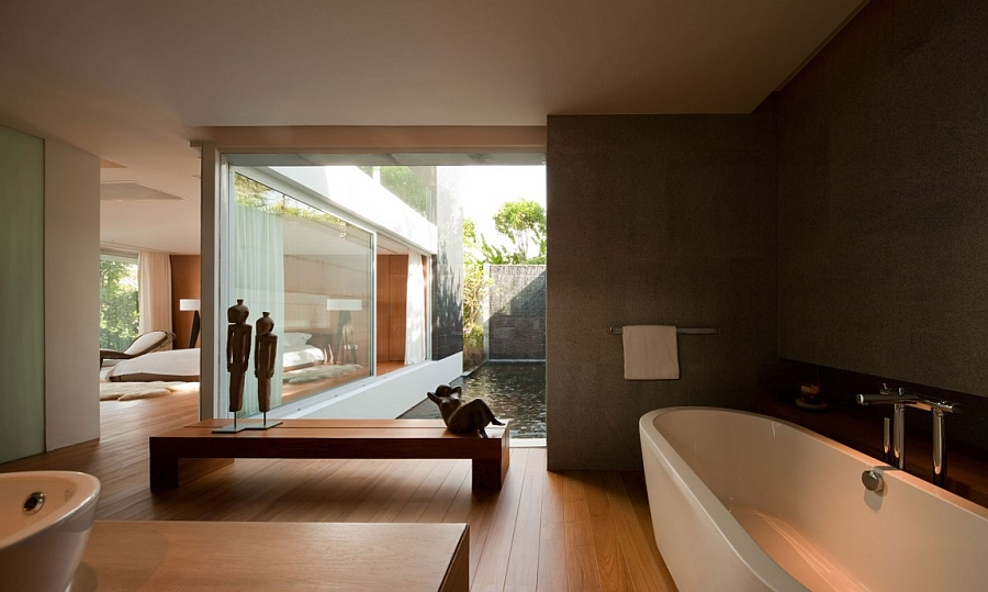 Stylish bath visually connected with the pond outdoors