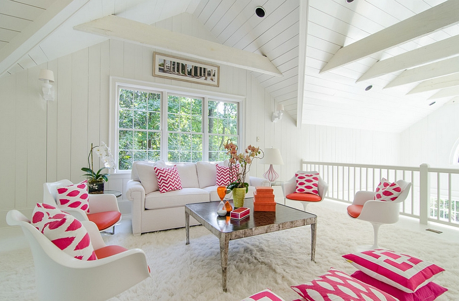 An all-white backdrop and plush rug bring in the feminine appeal