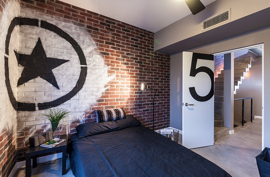 Industrial style bedroom with brick wall and trendy graffiti art [Design: CityLoft]