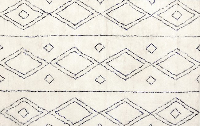 Navy and white diamond-pattern rug