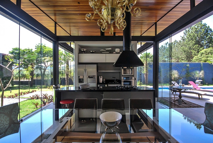 Open floor plan dining and kitchen space with a view of the outdoors