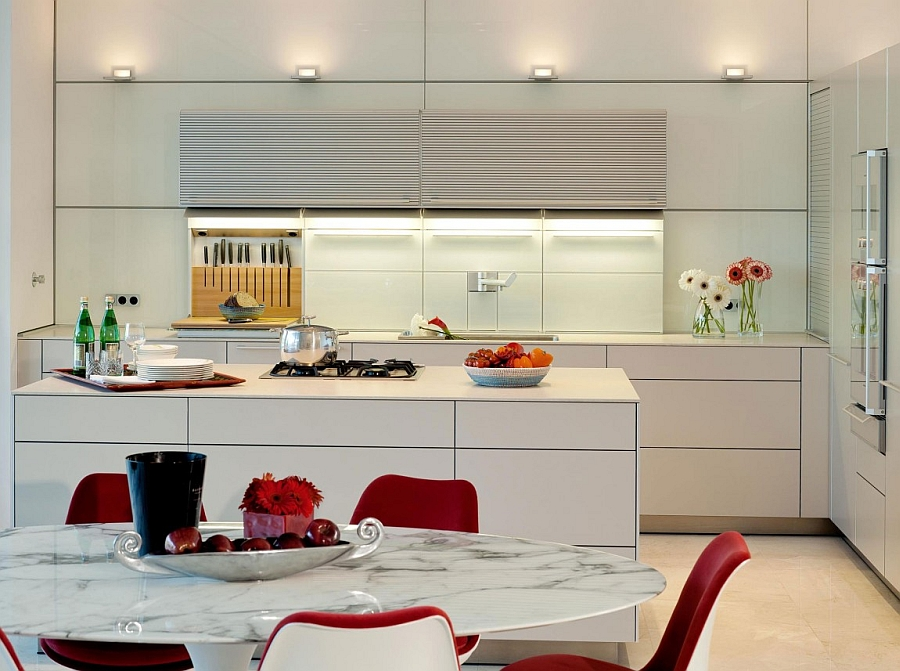 Sleek contemporary kitchen in white with smart shelves