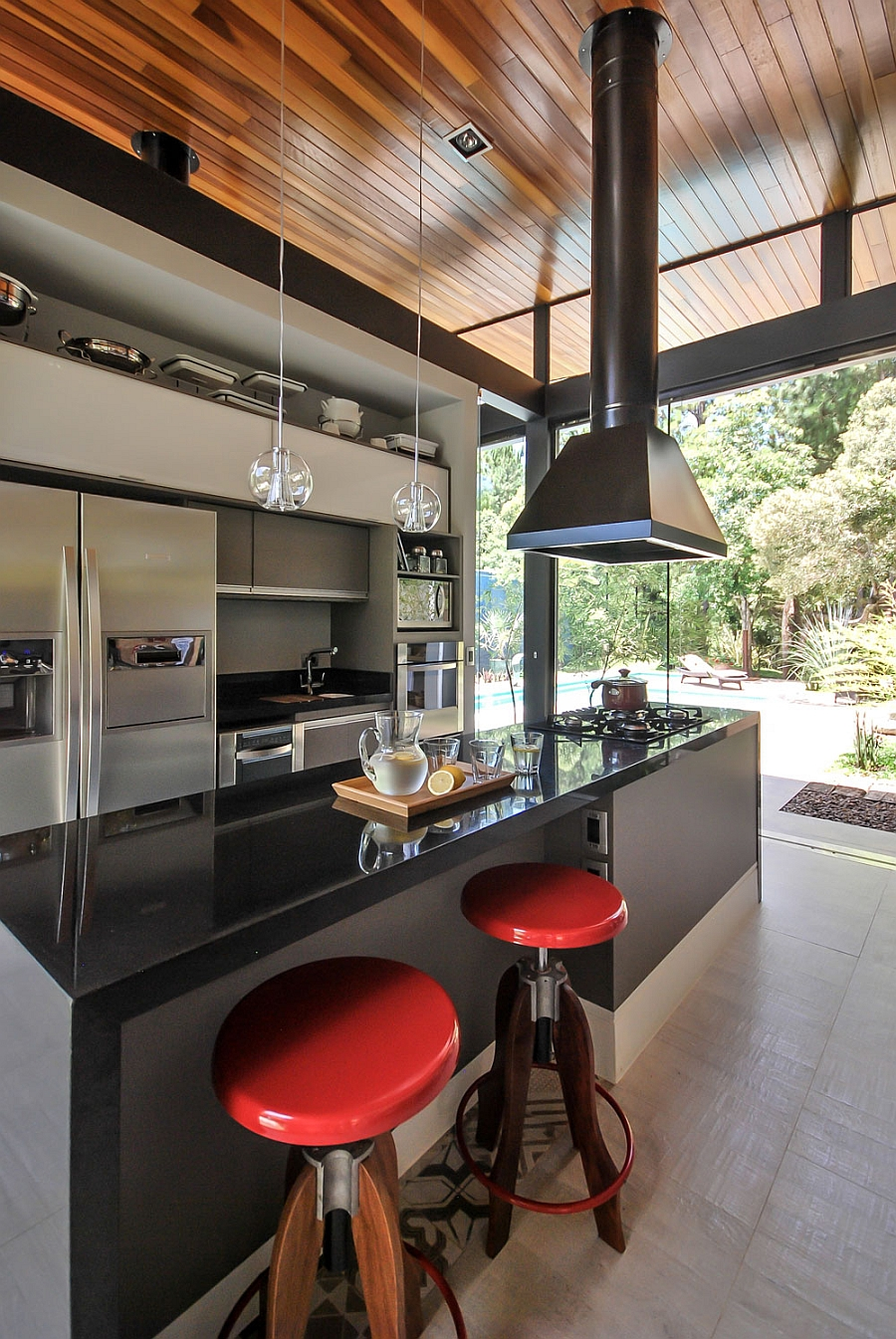 Smart modern kitchen that is connected with the backyard