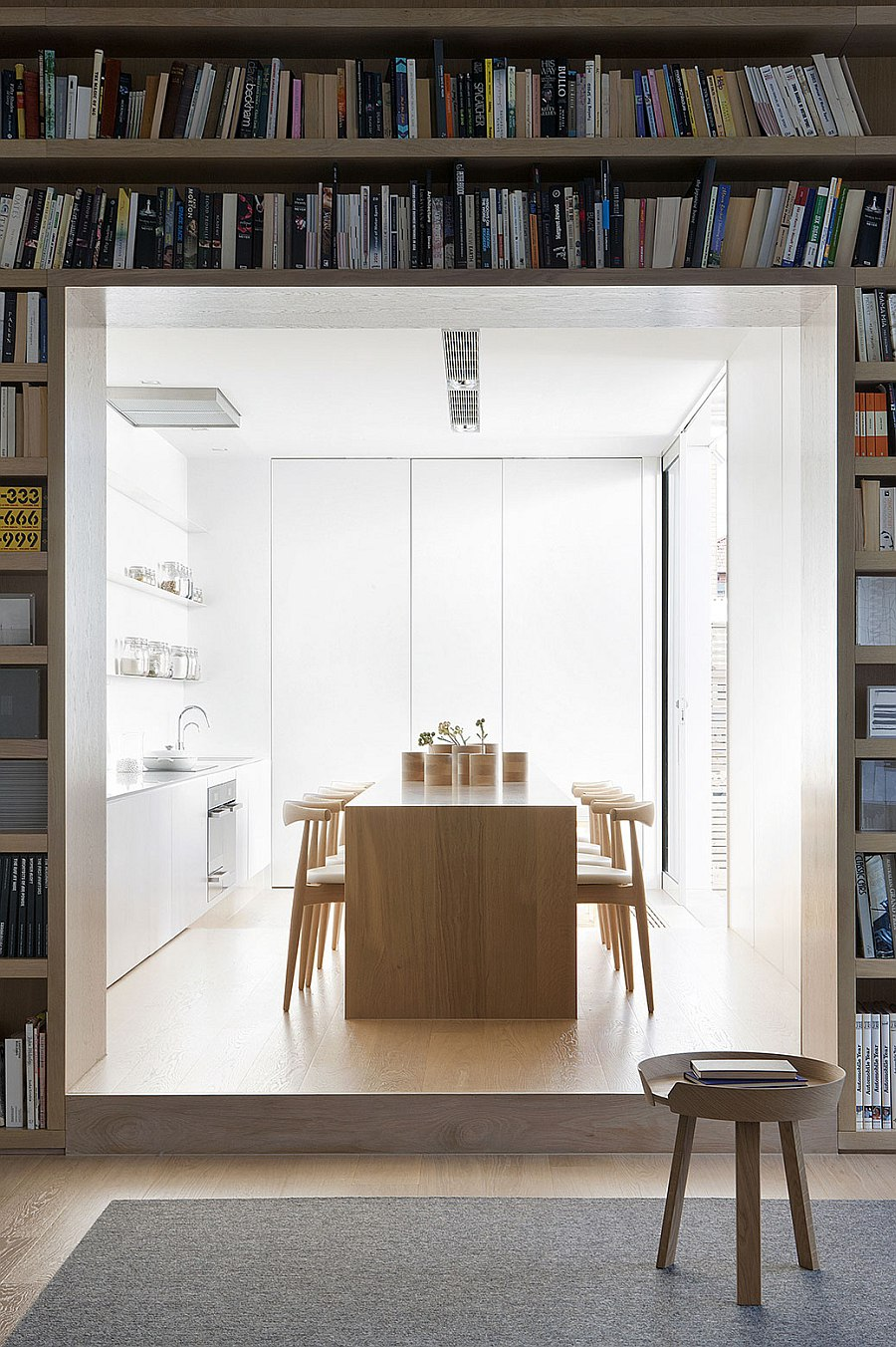 All white kitchen with wooden island at its heart