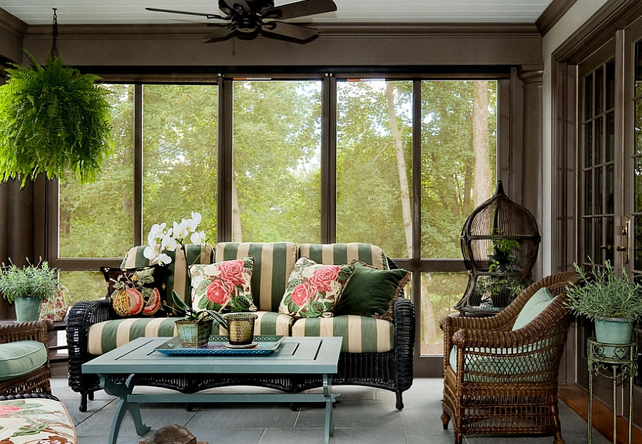 Birdcage blends in with the color scheme of the porch [Design: Crisp Architects]
