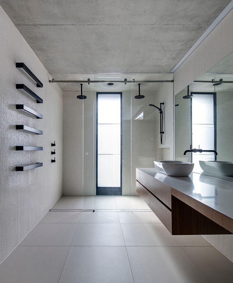 Floating wooden vanity in the bathroom lends visual airiness to the space
