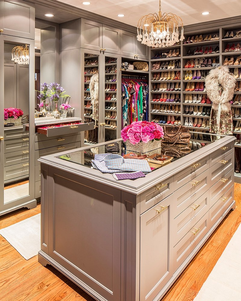 Grey and gold used elegantly in the feminine walk-in closet