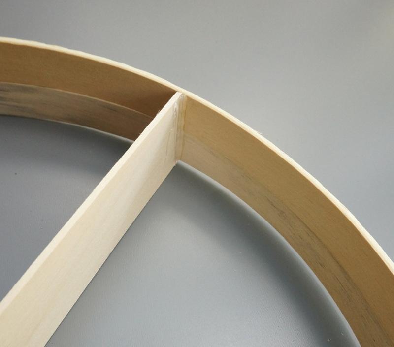 Hot glue on the underside of the round shelf