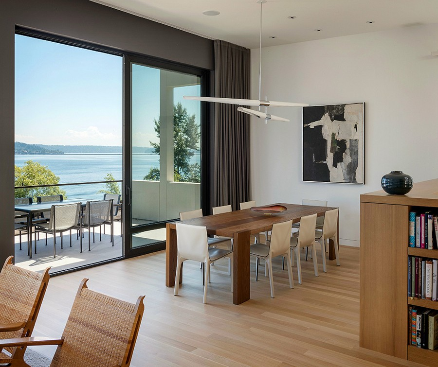 Indoor and outdoor dining space with a lake view