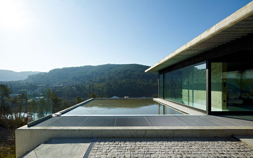 Outdoor courtyard with pool and river views