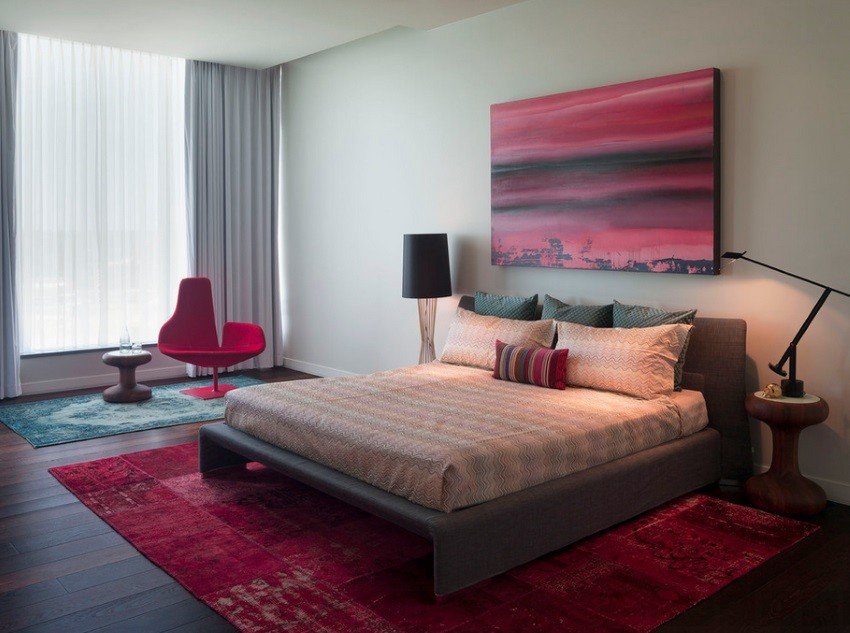 Overdyed rugs in a modern bedroom