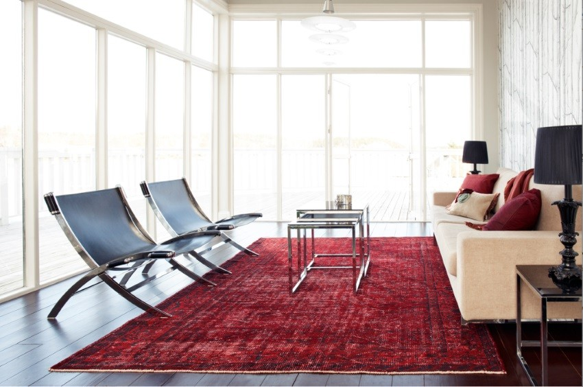 Red overdyed rug in a modern living room