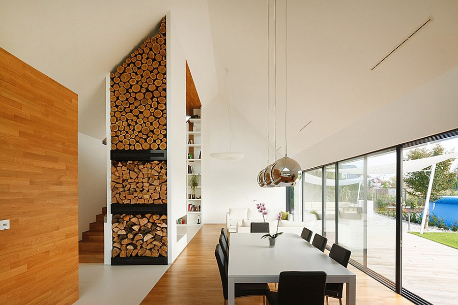 Stacked wood and metallic pendants give the space textural contrast