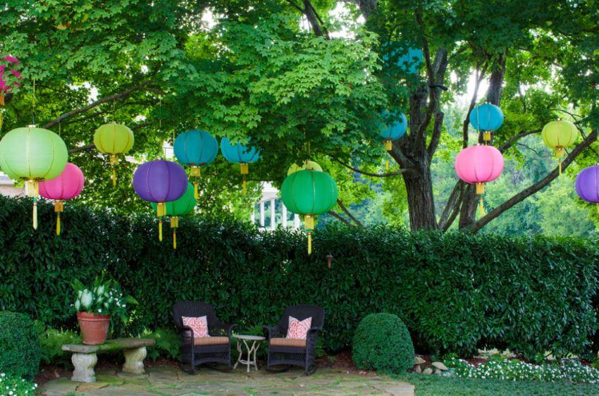 A festive backyard with hanging lanterns