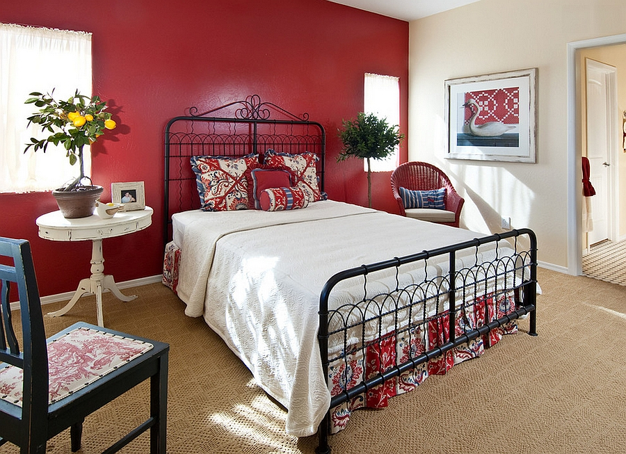 Cottage style bedroom with a gorgeous red backdrop [From: Design InSite]