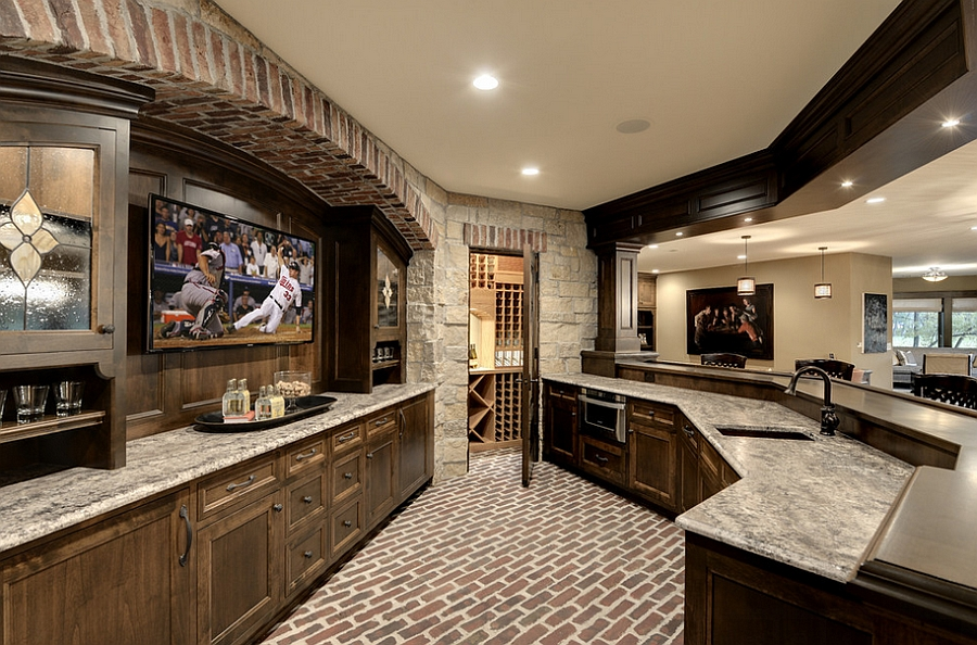 Wonderful use of space in the unique home bar creates the perfect man cave!