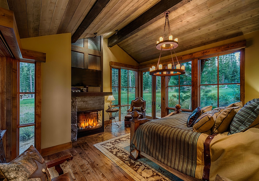 Woodsy cabin style bedroom with a fireplace