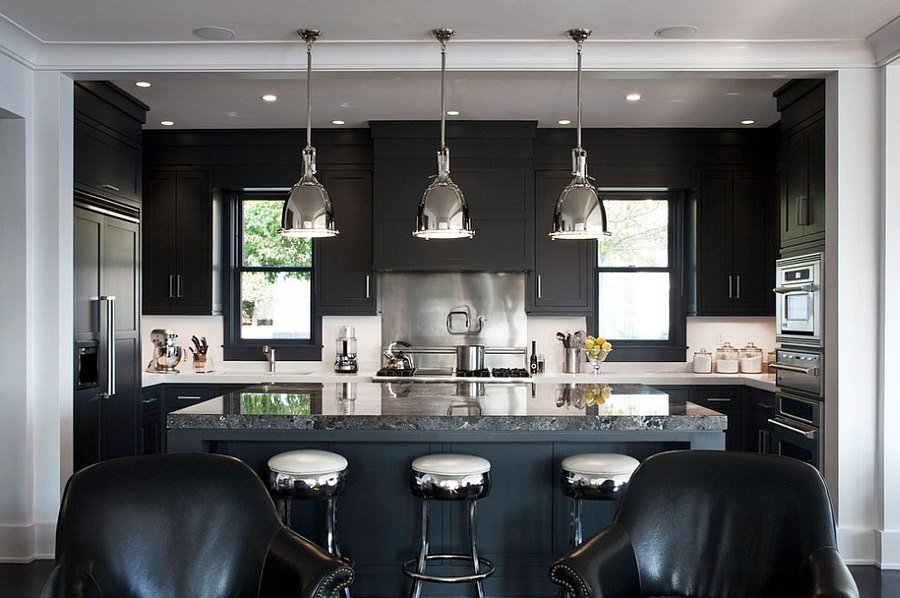 Black marble island adds a touch of luxury to the kitchen