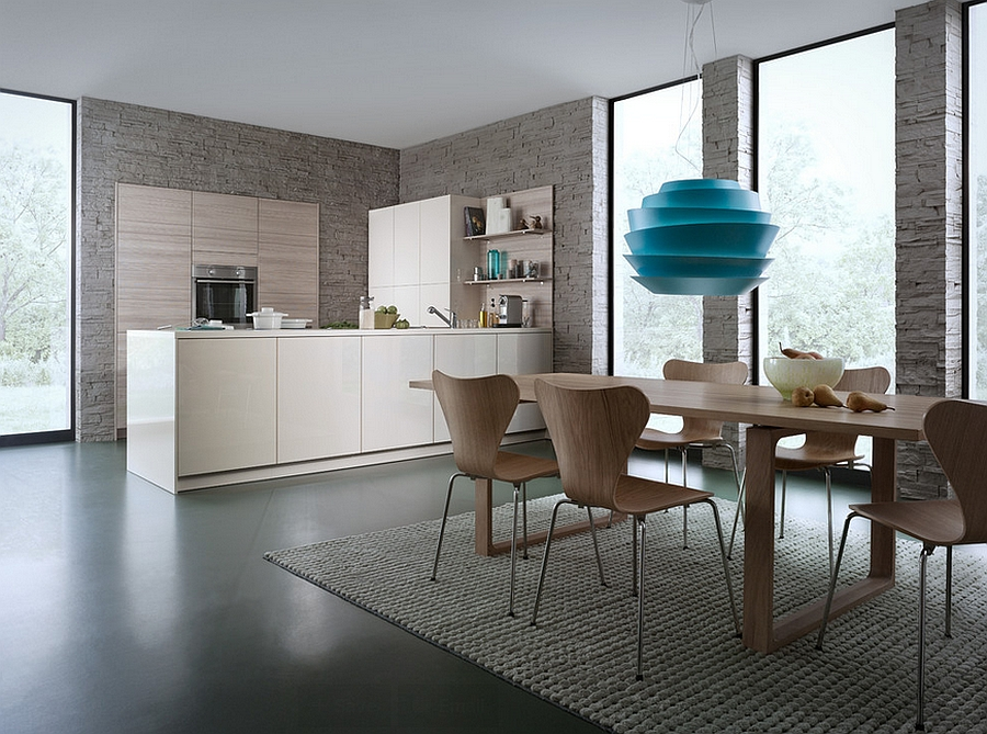 Cherner chairs and pendant light steal the show in this kitchen and dining space